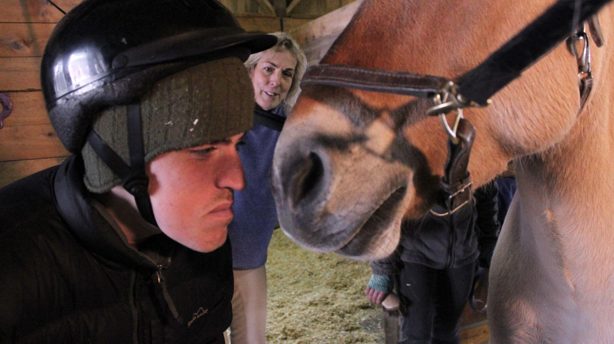 Andy Tranfaglia, who has fragile X, with Daniela Morse and Aurora the horse